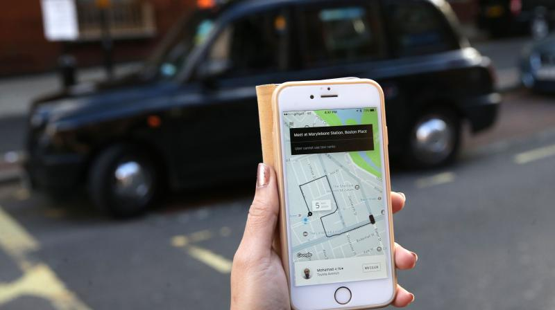 Uber signals recovery in rides as lockdown restrictions ease. (AFP Photo)