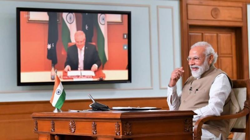 Prime Minister Narendra Modi with his Australian counterpart Scott Morrison during the virtual summit on Thursday. (PTII Photo)