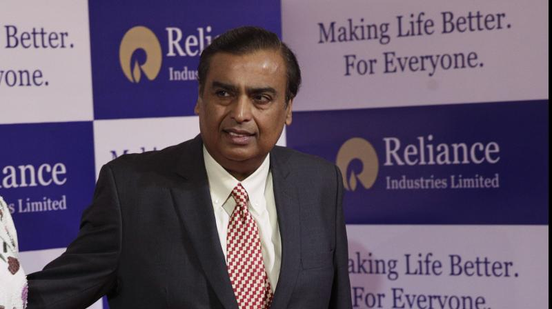 Reliance Industries shares hit 52-wk high after Abu Dhabi's Mubadala deal. (AP Photo)