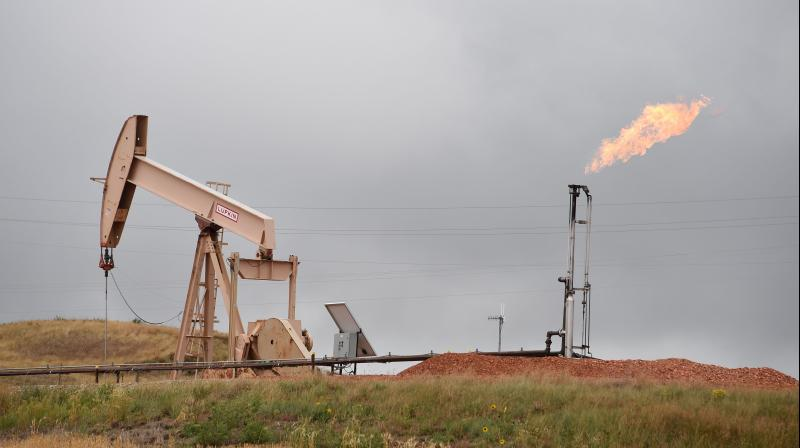 Oil prices inch higher, one-month supply cut extension falls short of market hopes. (AFP Photo)