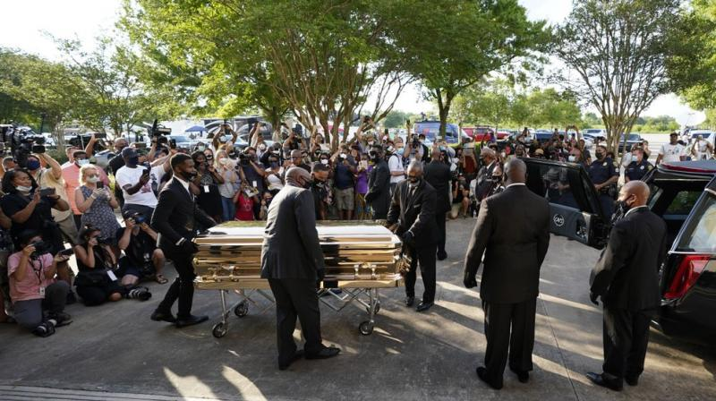The casket of George Floyd is removed after a public visitation for Floyd at the Fountain of Praise church, Monday, June 8, 2020, in Houston. (AP Photo)