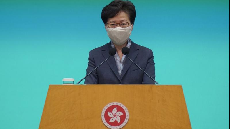 Hong Kong Chief Executive Carrie Lam listens to reporters questions during a press conference in Hong Kong, Tuesday, June 9, 2020. Lam said everyone should learn a lesson from last year's giant anti-government protests. But she did not say what lesson she has learned. Instead, she urged everyone to support the new national security legislation that the central government in Beijing is going to impose on Hong Kong. (AP Photo)