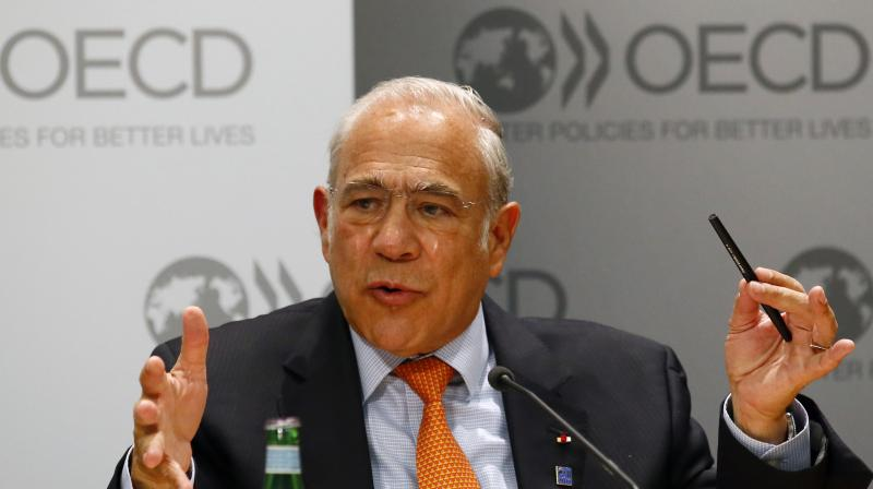 Secretary General of the Organisation for Economic Co-operation and Development (OECD), Jose Angel Gurria. Global economy to contract at least 6% in 2020, says OECD. (AP Photo)