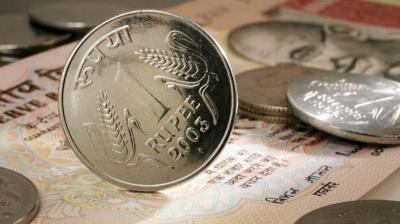 Rupee slumps 26 paise to close at 73.87 against US dollar