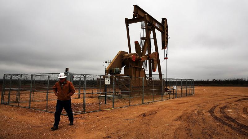 Oil prices nudged higher on Monday on tighter supplies from major producers. (AFP Photo)