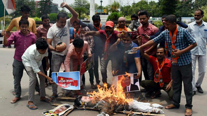 Traders' body CAIT on Monday burnt Chinese goods in Delhi's main market Karol Bagh. (PTI Photo)