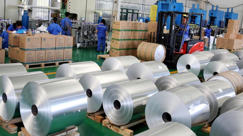 Workers transferring aluminium foil for export to India at a factory in Huaibei in China's eastern Anhui province. India initiates probe into alleged dumping of aluminium foil from 4 nations. (AFP Photo)