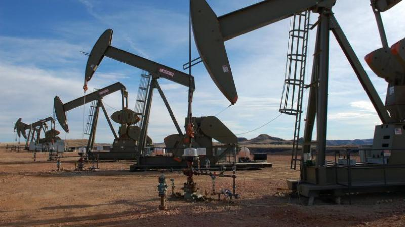Oil futures dropped on Wednesday after US crude stockpiles grew more than expected. (AFP Photo)