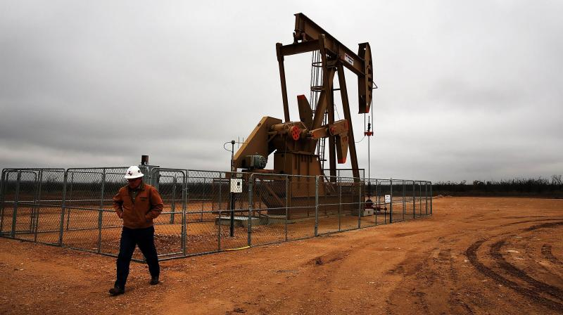 Oil prices creep up on demand recovery, tempered by virus outbreaks. (AFP Photo)