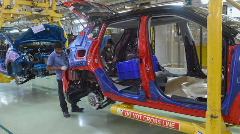 India relies on China for products such as auto components and drug ingredients because it cannot make them or source them elsewhere as cheaply. (AFP Photo)