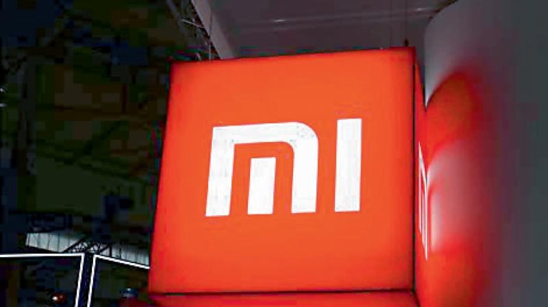 Chinese handset maker Xiaomi has begun covering its retail store branding with 'Made in India' logo. (PTI Photo)