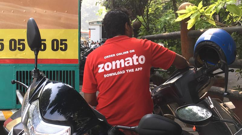 Group of Zomato food delivery platform employees in Kolkata tore and burnt their official T-shirts. (PTI Photo)