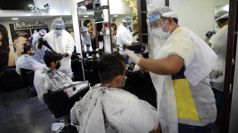 Mumbaikars thronged salons which were thrown open after 3 months of lockdown in the city. (DC Photo- Rajesh Jadhav)