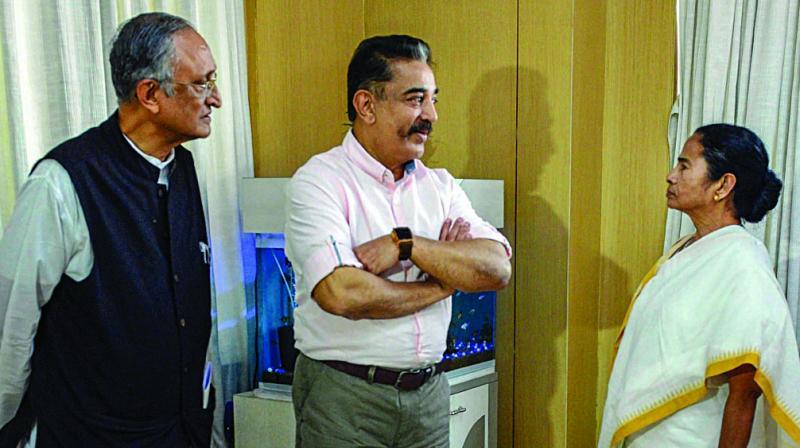 West Bengal chief minister Mamata Banerjee, MNM president Kamal Haasan and state finance minister Amit Mitra at Nabanna in Kolkata. (Photo: PTI)