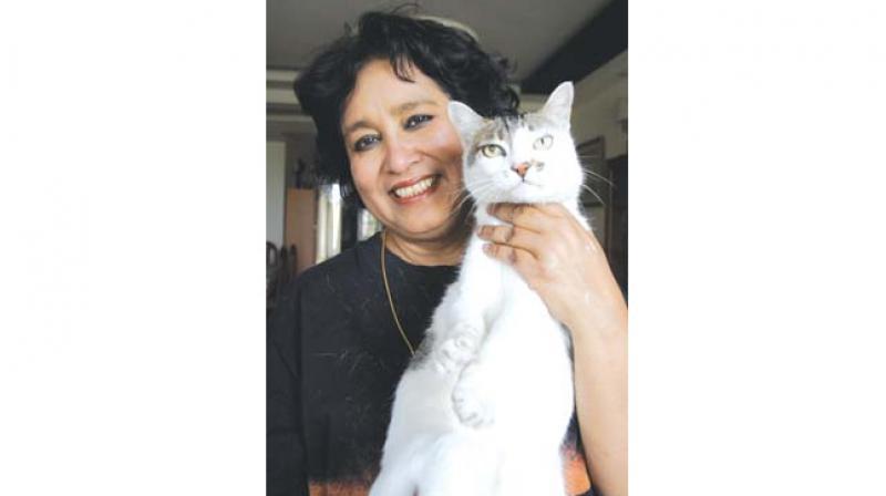 Taslima Nasrin with her cat Minu at her New Delhi home (Photo: Sondeep Shankar)