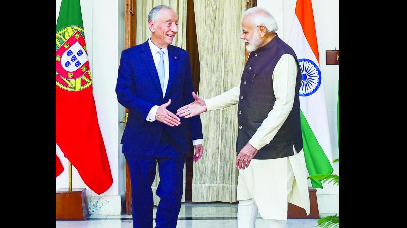 Prime Minister Narendra Modi shakes hands with Portuguese President Marcelo Rebelo de Sousa at Hyderabad House on Friday. (Photo: PTI)