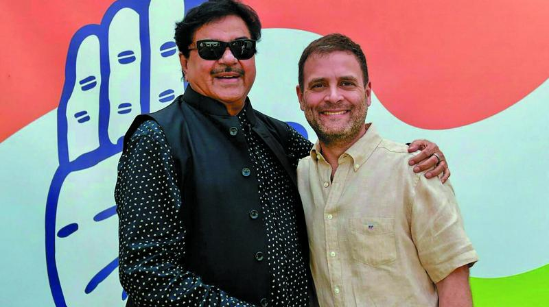 Congress chief Rahul Gandhi meets Shatrughan Sinha in New Delhi on Thursday. The actor is set to formally join the Congress on April 6. (Photo: PTI)