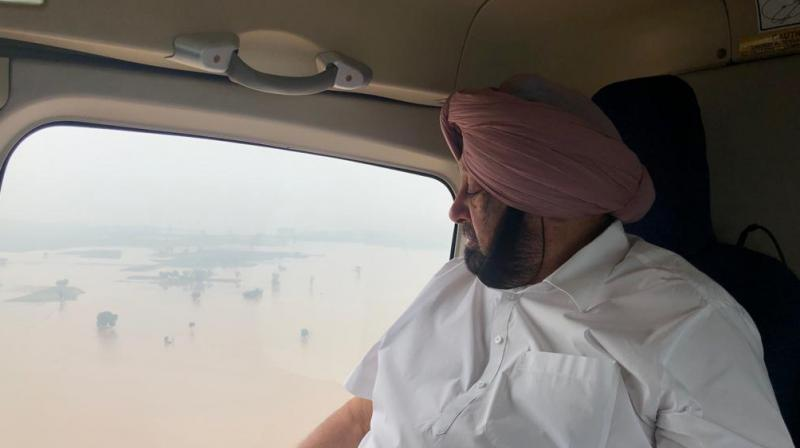 'The situation is not that good on both sides of Ghaggar river. The water has gone up to Bathinda. Nobody expected that the water would come to this level by the end of July. Normally, the flooding occurs in August in Punjab but the rains have aggravated the situation in this month,' the Chief Minister said. (Photo: Twitter I capt _amarinder)