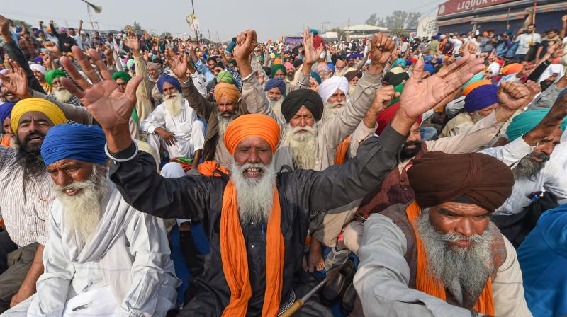 Farmers during their 'Delhi Chalo' protest march against the new farm laws, at Singhu border in New Delhi, Sunday, December 6 (PTI/Manvender Vashist)