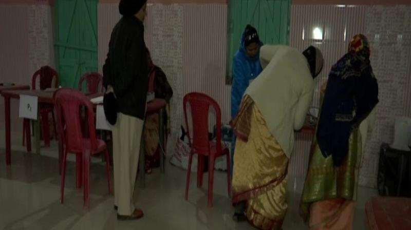 The polling that began at 7 am in all Assembly segments will end at 3 pm in five constituencies of Borio (ST), Barhait (ST), Litipara (ST), Maheshpur (ST) and Sikaripara (ST). (Photo: ANI)