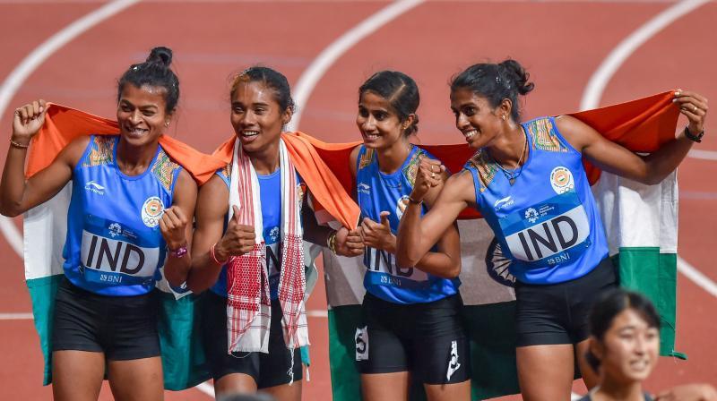 The Indian quartet of Hima Das, M R Poovamma, Saritaben Gayakwad and Vismaya Velluva Koroth clocked 3:28.72sec to claim the gold. (Photo: PTI)
