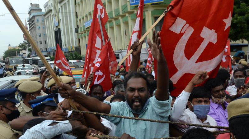 A member of the Communist Party of India protests against the government's new legislations. (AFP)