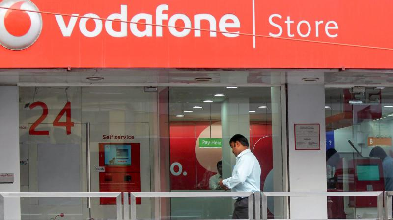 In this 2012 file photo, a visitor walks into a Vodafone store in Bangalore. British telecom giant Vodafone Group plc on Sept. 25, 2020 won an arbitration against the Indian government over a demand for Rs 22,100 crore in taxes using retrospective legislation. (PTI)