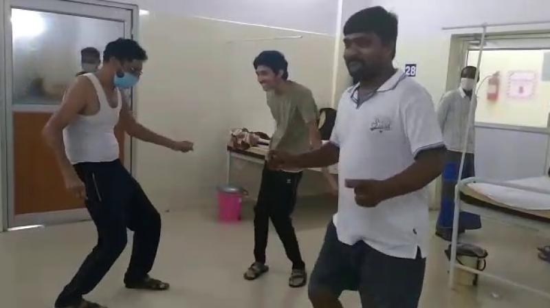 Nalco employee G Ramesh Kumar (left) performing disco dance in a Covid hospital. — DC photo
