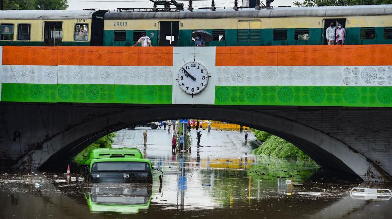 A DTC bus almost submerged at waterlogged Minto Bridge underpass after rains in New Delhi. PTI photo