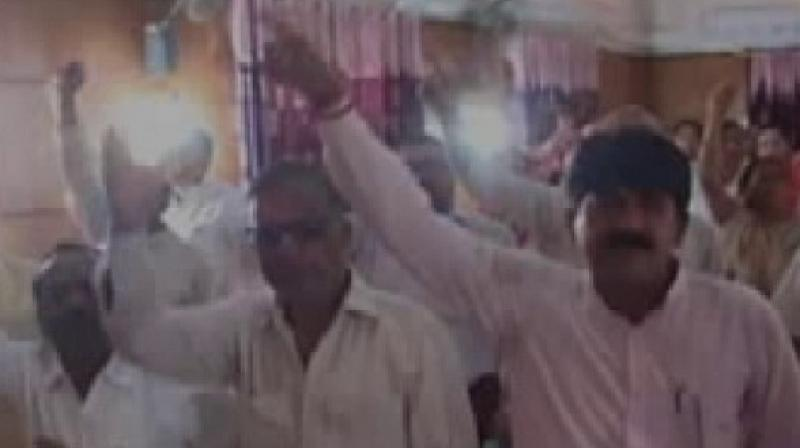 The corporators returned to the meeting after a brief while but Ahluwalia refused to let them in. (Photo: ANI)