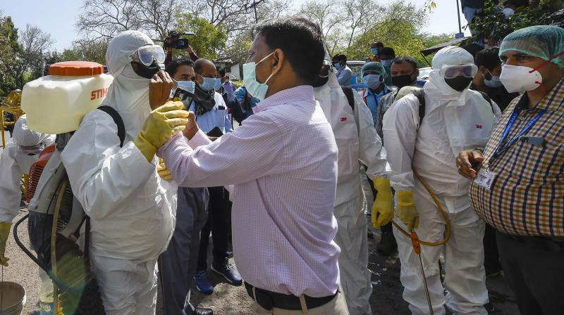 Health workers prepare to sanitise an area near Nizamuddin mosque, after people who attended the religious congregation at Tabligh-e-Jamaat's Markaz, tested postive for COVID-19, in New Delhi. PTI image