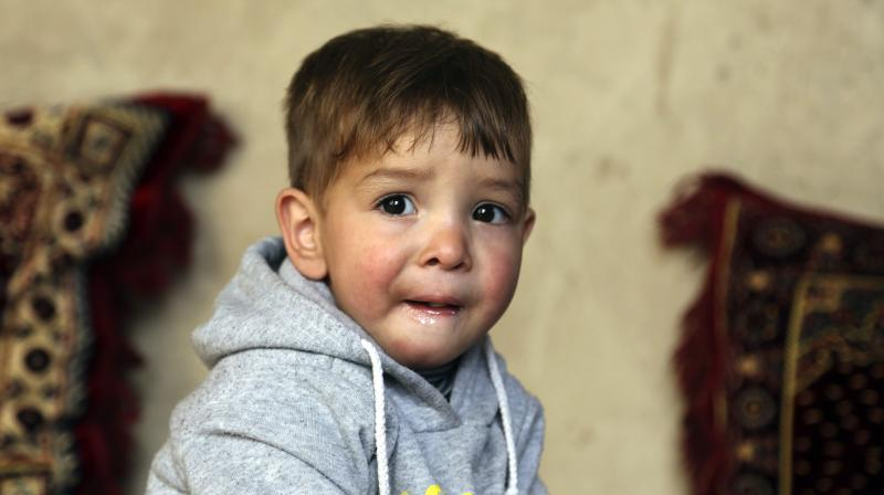 The rosy-cheeked toddler's parents named him after the billionaire US president in the hope of replicating his success. (Photo: AP)