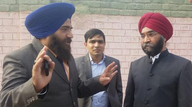 Indian diplomat Ranjit Singh (in red turban) was denied access to two gurudwaras in Pakistan. (Photo: ANI/Twitter)