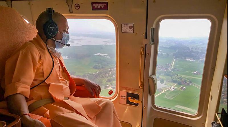 UP chief minister Yogi Adityanath did an aerial survey of the flood hit regions of Uttar Pradesh. PTI photo