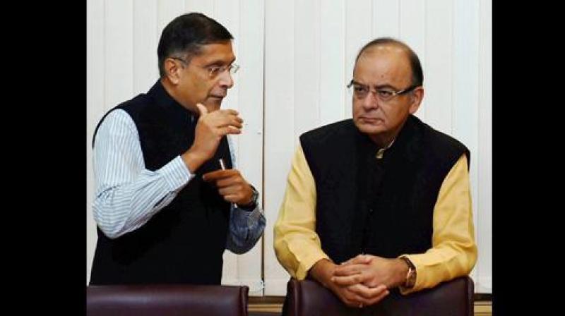 Finance Minister Arun Jaitley with Chief Economic Adviser Arvind Subramanian. (Photo: PTI)