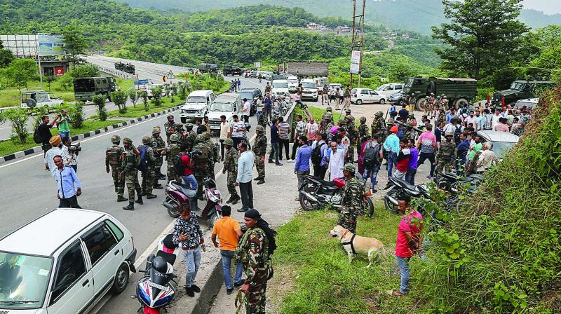 Army and police personnel carry out a search operation after militants opened fire at a police post at Jahjar Kotli on Srinagar-Jammu highway on Wednesday. (Photo:PTI )