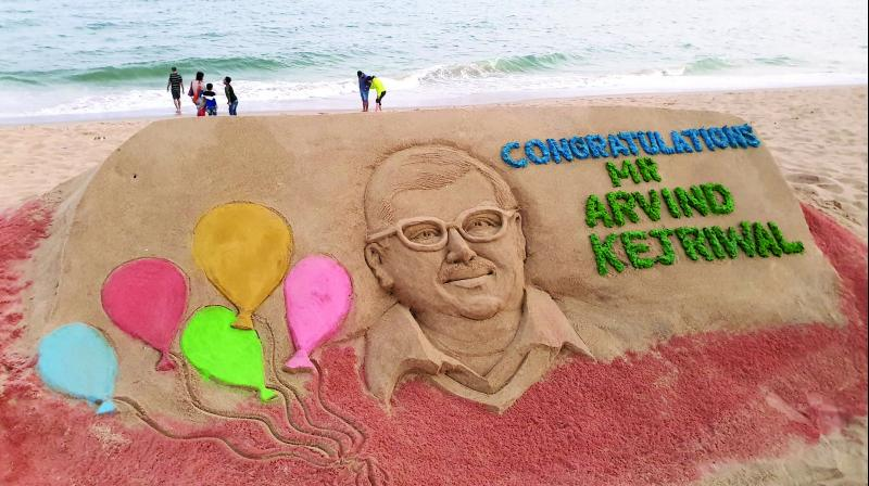 Renowned sand artist Manas Kumar Sahoo congratulated Arvind Kejriwal for AAP's astounding victory in Assembly elections through his art work at Puri beach in Odisha on Tuesday.