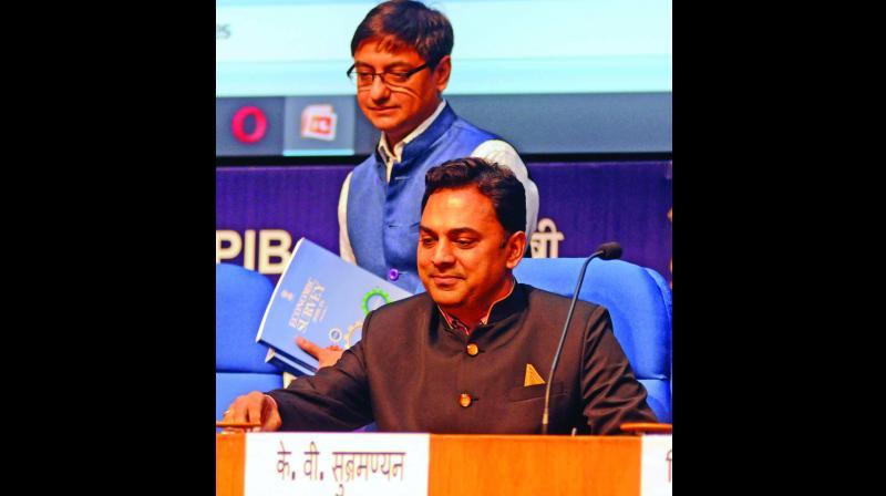 Chief economic adviser K. Subramanium and principal economic adviser Sanjiv Sanyal (standing) at the release of Economic Survey in New Delhi on Thursday. (Photo: G.N. Jha)