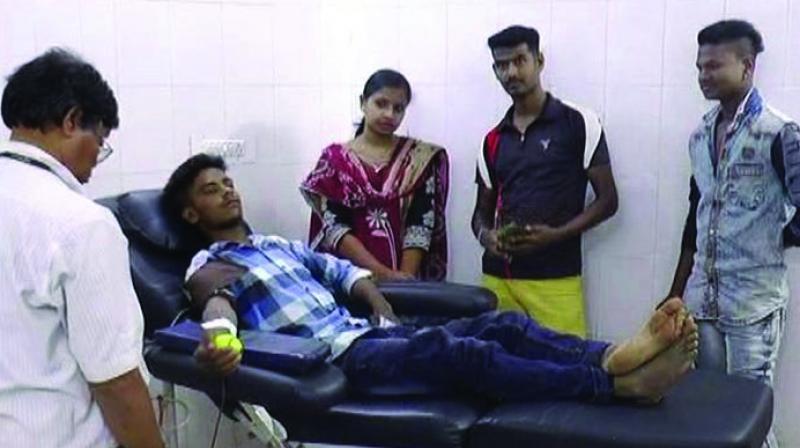 Shaikh Shaqir donating blood.