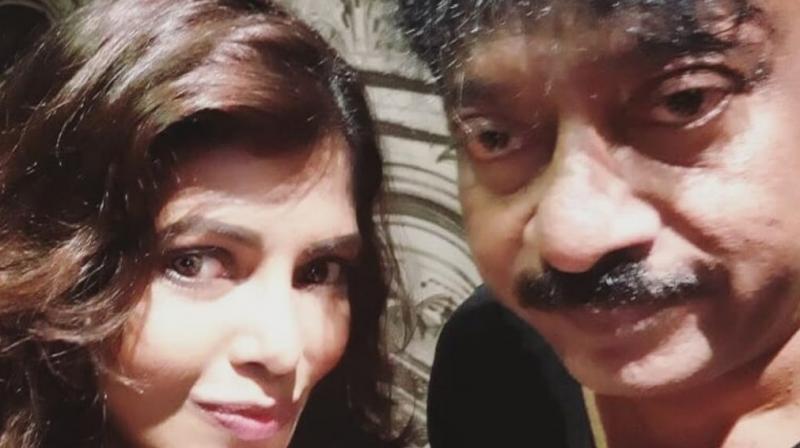 Ram Gopal Varma with Luviena Lodh.