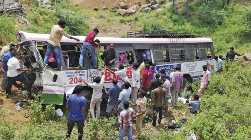 Rescuers pull out passengers from a bus that fell into a gorge in Telangana's Jagtial district. (Photo: AP)