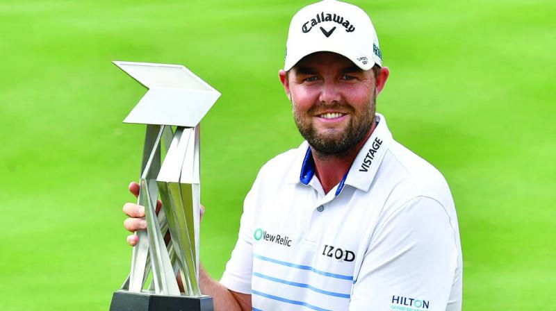 Marc Leishman of Australia poses with the trophy after winning the CIMB Classic golf tournament in Kuala Lumpur on Sunday. (Photo: AFP)