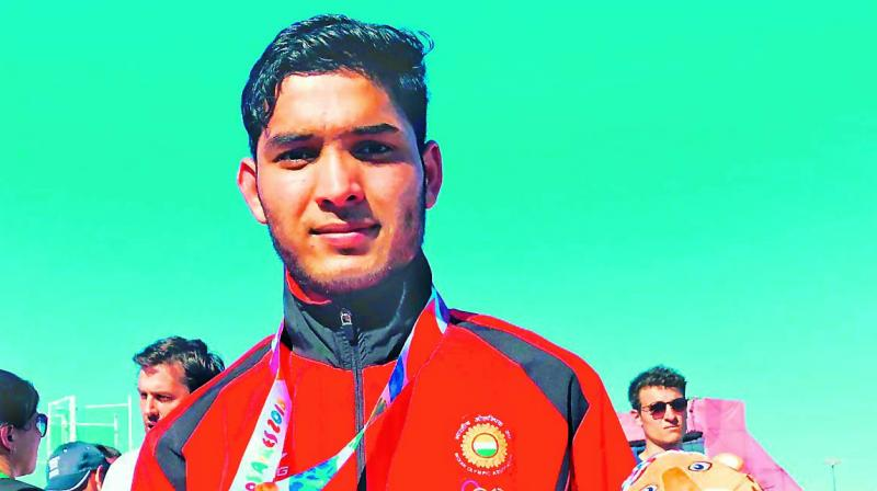 Suraj Panwar shows his silver medal from the Youth Olympic Games in Buenos Aires, Argentina.