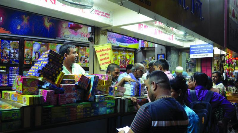 People buying fire crackers at Mohammed Ali Road.