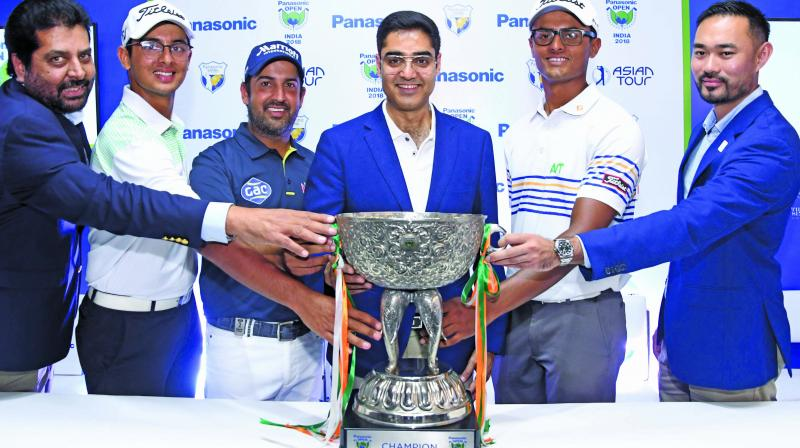 Golfers Kshitij Naveed Kaul (second from left), defending champion Shiv Kapur and Viraj Madappa pose with the Panasonic Open India trophy in New Delhi on Wednesday.