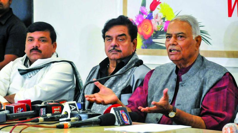 (Right to left)Former Union minister Yashwant Sinha, BJP MP Shatrughan Sinha and AAP MP Sanjay Singh hold a press conference in Nagpur. (Photo: PTI)