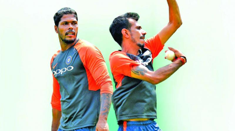 Umesh Yadav (left) Yuzvendra Chahal at a training session at Thiruvananthapuram on Wednesday. (Photo: AFP)