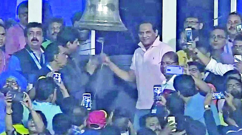 Former India captain Mohammad Azharuddin rings the bell at Eden Gardens in Kolkata ahead of the first T20I.