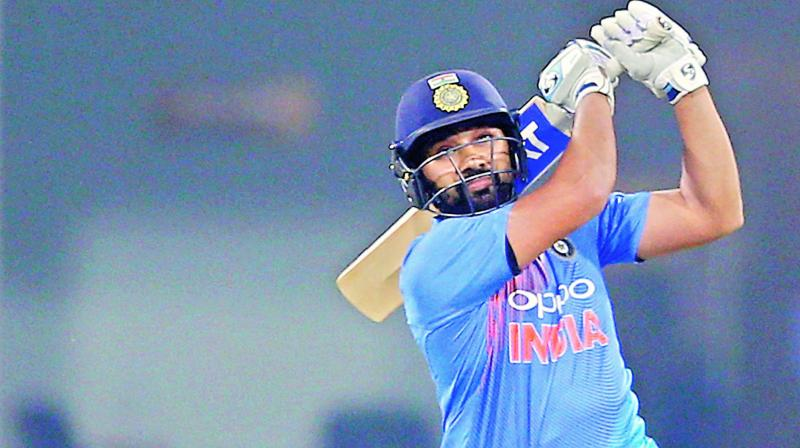 Rohit Sharma hits a six during the second  Twenty20 international against West Indies at Bharat Ratna Shri Atal Bihari Vajpayee Ekana Cricket Stadium in Lucknow, India on Tuesday.  (Photo: AP)