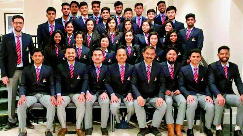 The Indian squad for the World Junior Badminton Championship being held at Markham in Canada, are all smiles in this team photo.